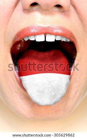 Indonesian flag on woman tongue. Learning indonesian language - stock photo