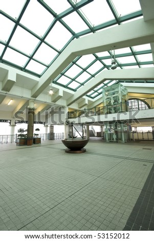indoor area of ferry habour,but many young use it for dance in hong kong - stock photo