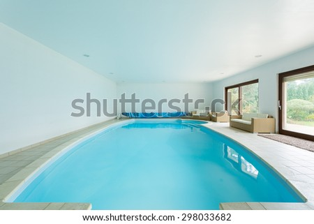 Indoor clean swimming pool in luxury mansion - stock photo