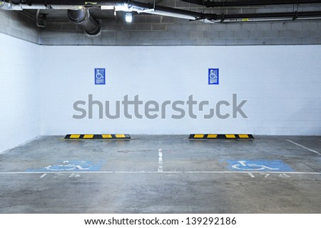 Indoor disabled parking - stock photo