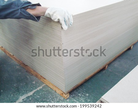 Indoor Factory Warehouse for Fiber Cement Board Storage - stock photo