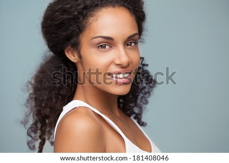 Indoor portrait of a beautiful smiling African woman. - stock photo