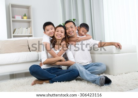 Indoor portrait of asian mixed race family - stock photo