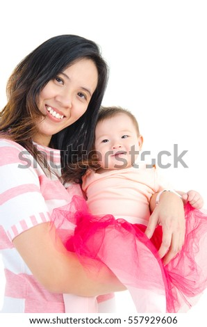 Indoor portrait of asian mother and her baby girl