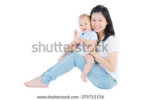 Indoor portrait of beautiful asian woman and her lovely baby - stock photo