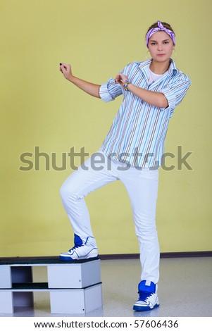 indoor portrait of hip-hop dancer girl - stock photo