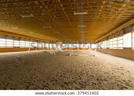 indoor sand ring for hunter jumper riding - stock photo