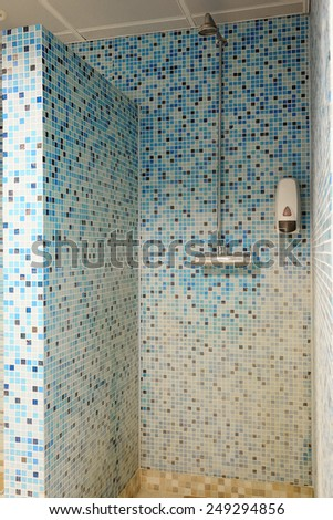 Indoor shower at swimming pool - stock photo