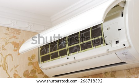 Indoor unit air conditioner opened for maintenance - stock photo