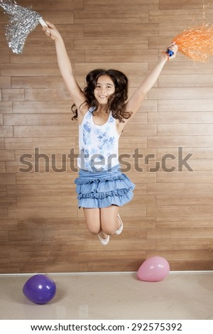 Indoor Young child jumping and have fun  - stock photo