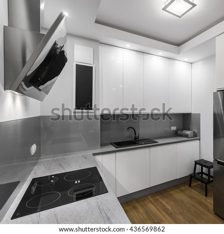 Induction hob in modern and elegant designed kitchen - stock photo