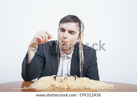Indulgence and consumerism concept. Gluttonous businessman eating pasta.