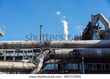 Industrail chimneis and pipes, part of the working process in an industrial smelter, foundry factory AURUBIS, November 06, 2015.