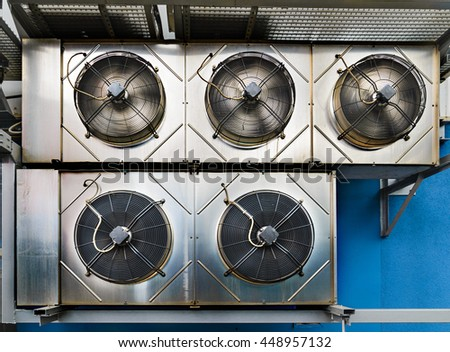 Industrial air conditioning units. Five cooling modules hang on the wall of a building. - stock photo