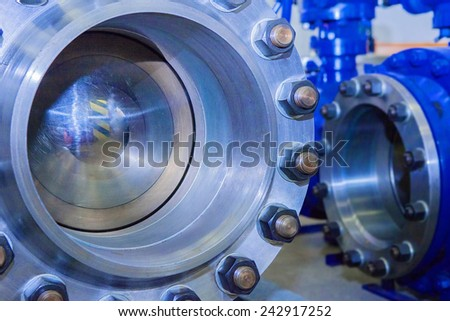 Industrial big dimentions ballvalves in industrial warehouse - stock photo