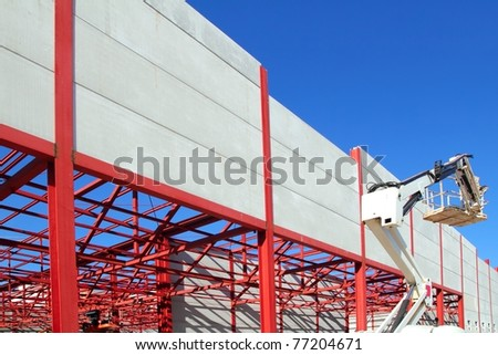 industrial building construction steel structure crane concrete wall - stock photo