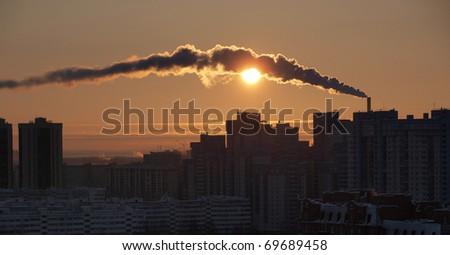 industrial buildings, sunset sky - stock photo