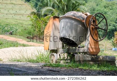 Industrial cement mixer machine - stock photo