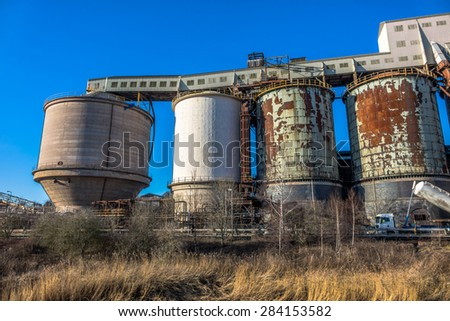 Industrial chemical plant with large tanks. - stock photo