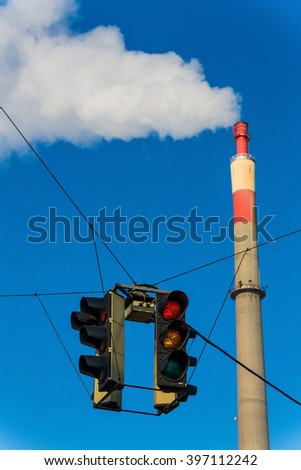 industrial chimney and red light - stock photo