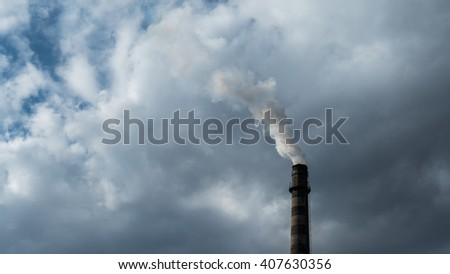 Industrial chimney polluting the air - stock photo