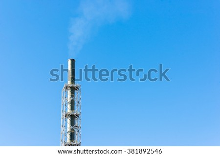 Industrial chimneys and pipes, part of the working process in an industrial smelter, foundry factory. - stock photo