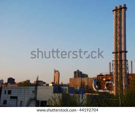 industrial city view with chimneys and skyscraper