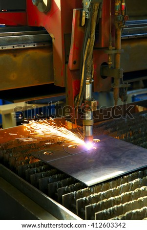 Industrial cnc plasma cutting of metal plate. Closeup