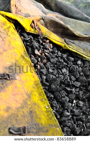 Industrial coal in yellow bag ready for the winter - stock photo
