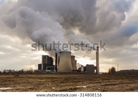 industrial coal power plant with cloudy sky  - stock photo