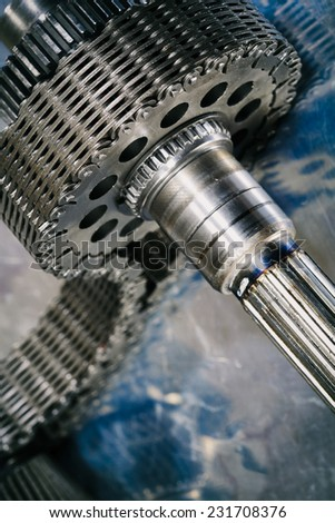 industrial cogwheels powered by timing chain, titanium and steel - stock photo