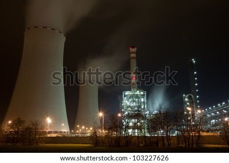 Industrial complex with cooling towers - stock photo