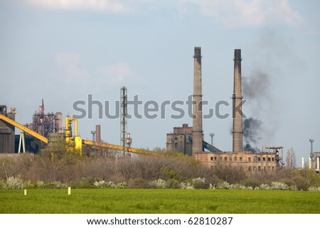 Industrial complex with smoke rising