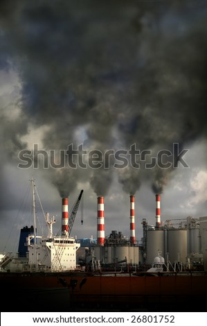 Industrial complex with smokestacks blowing pollution into the air - stock photo