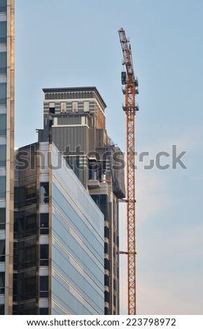 Industrial construction cranes and building - stock photo