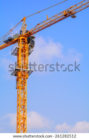 Industrial construction cranes on the blue sky background - stock photo
