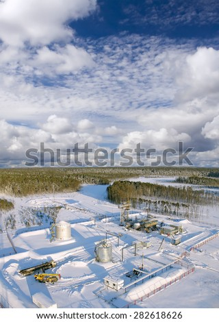 Industrial construction. Oil industry. Mounting of pipework in wild Siberian taiga. Gas transfer station. - stock photo