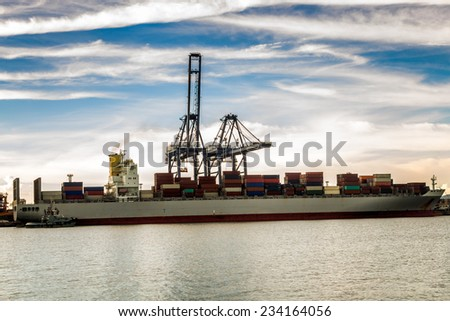 Industrial Container Cargo freight ship with working  - stock photo