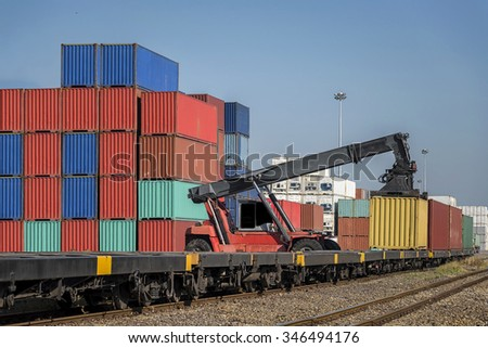 Industrial Container Cargo with working crane to railway transportation to habour in Logistic Import Export area - stock photo