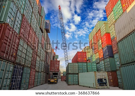 Industrial crane loading container to truck for logistic Import Export concept - stock photo