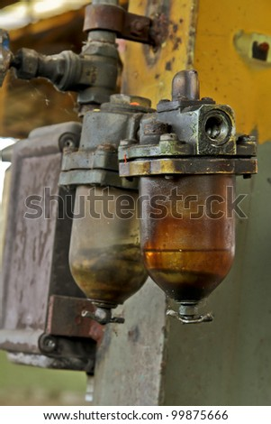 industrial device with oily liquids - stock photo