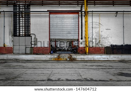 Industrial door of an old factory - stock photo