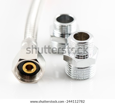 industrial elastic metal fiber water pipe with connectors on white background - stock photo