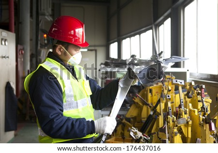 Industrial engineer checking quality metal