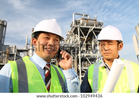 industrial engineer communicate with mobile phone