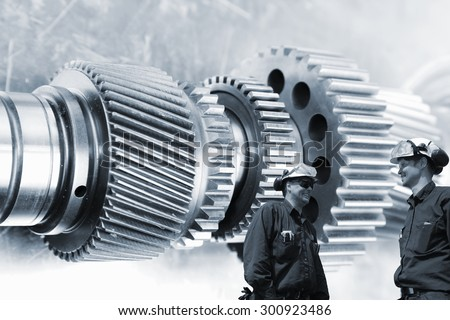 industrial engineers, workers with large cogwheels and gears machinery, metal blue toning concept with focal-point on workers - stock photo