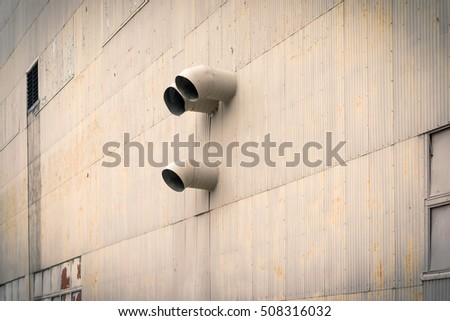 Industrial Exhaust Vents on the Side of a Fabrication Plant.