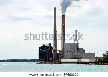 industrial factory on a lake - stock photo