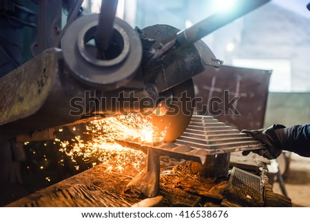 Industrial factory power tool used by worker for grinding and cutting steel - stock photo