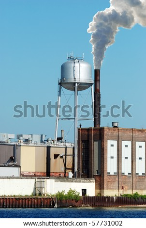 industrial factory water tower - stock photo